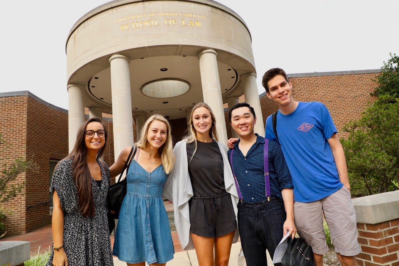 Students at front of building