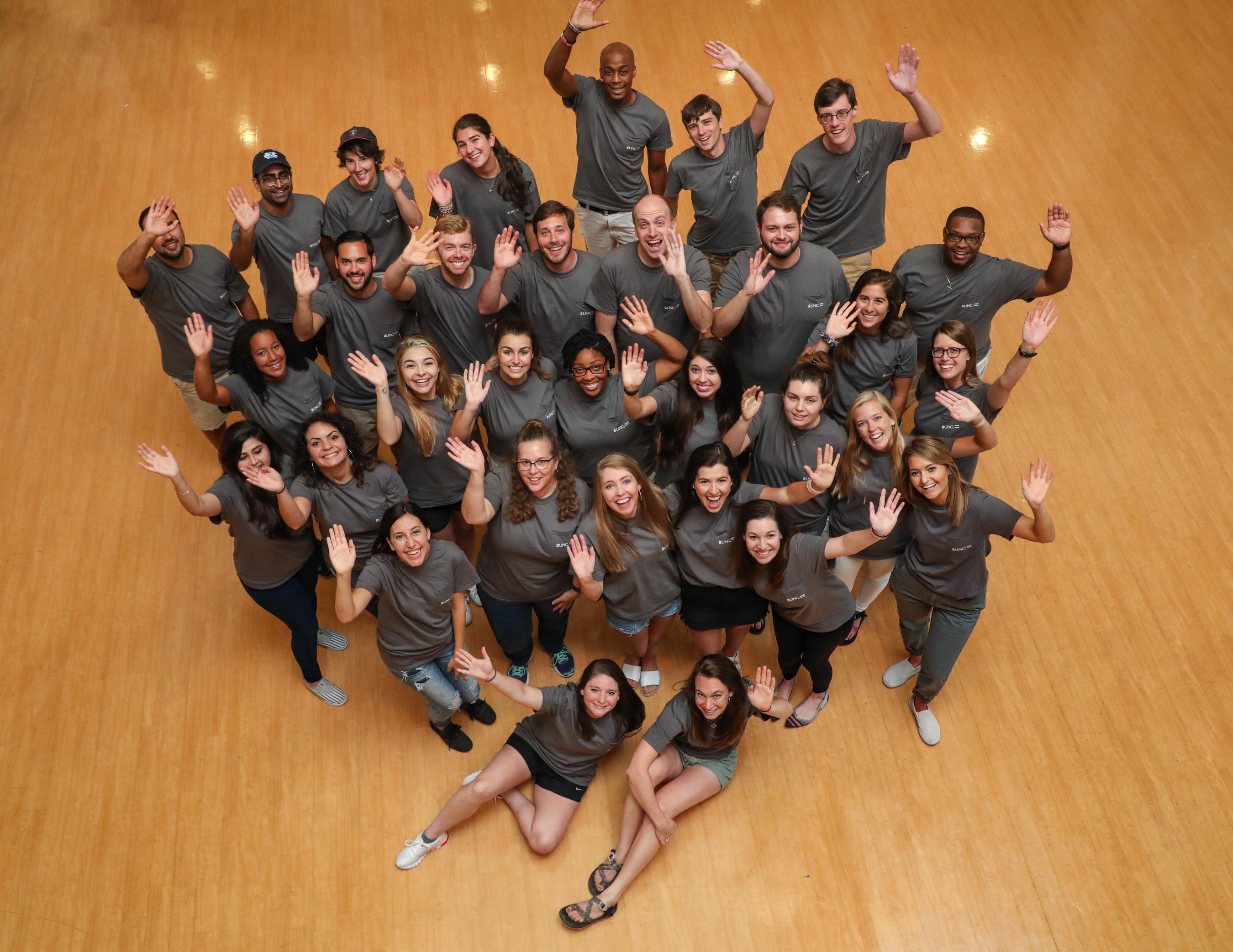 Dean's Fellows waving